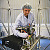 Engineer at work on test bed for mini- and microsatellite buses