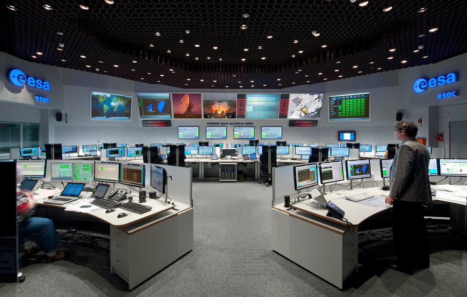 ESA's European Space Operations Centre (ESOC) is the Operation Control Centre for ESA missions. Shown here is the Main Control Room.