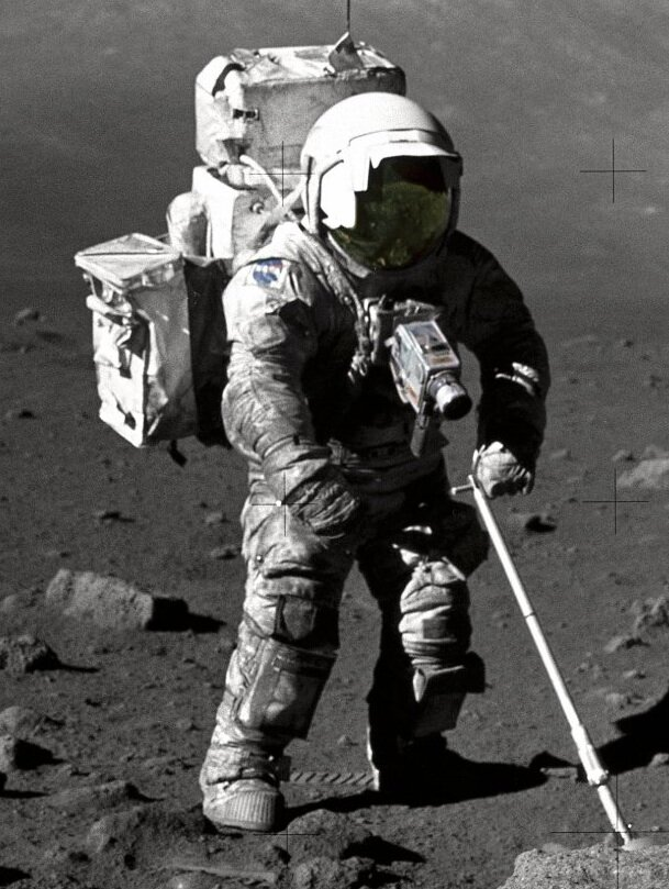 Apollo astronaut collecting dust samples