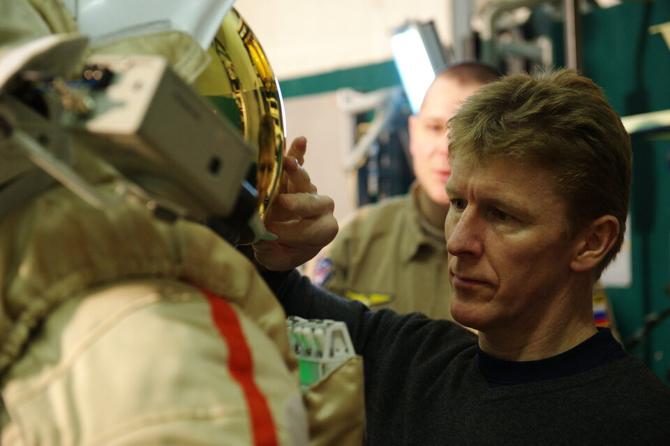 Tim checks Russian spacesuit