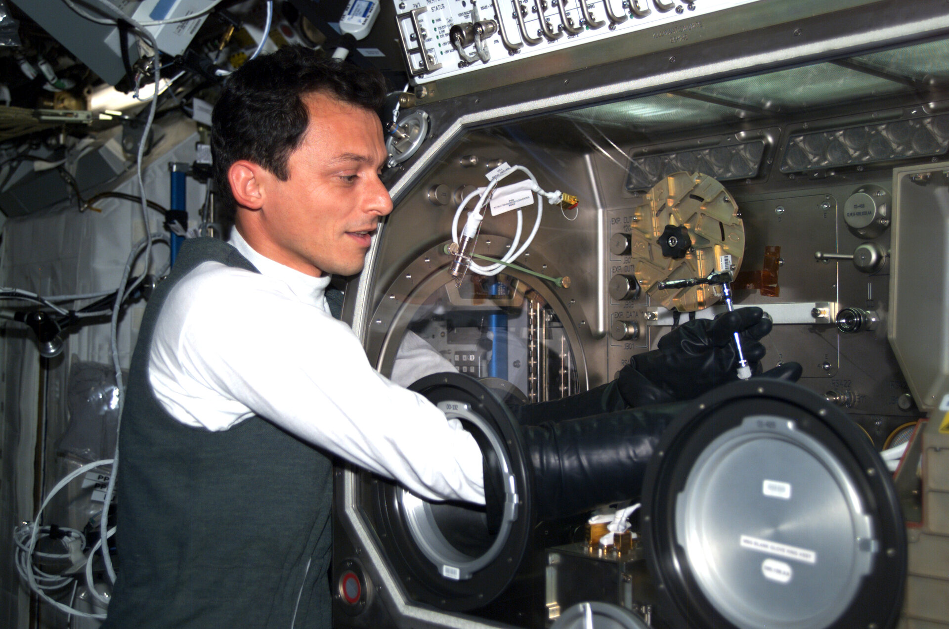 ESA astronaut Pedro Duque with Microgravity Science Glovebox in 2003