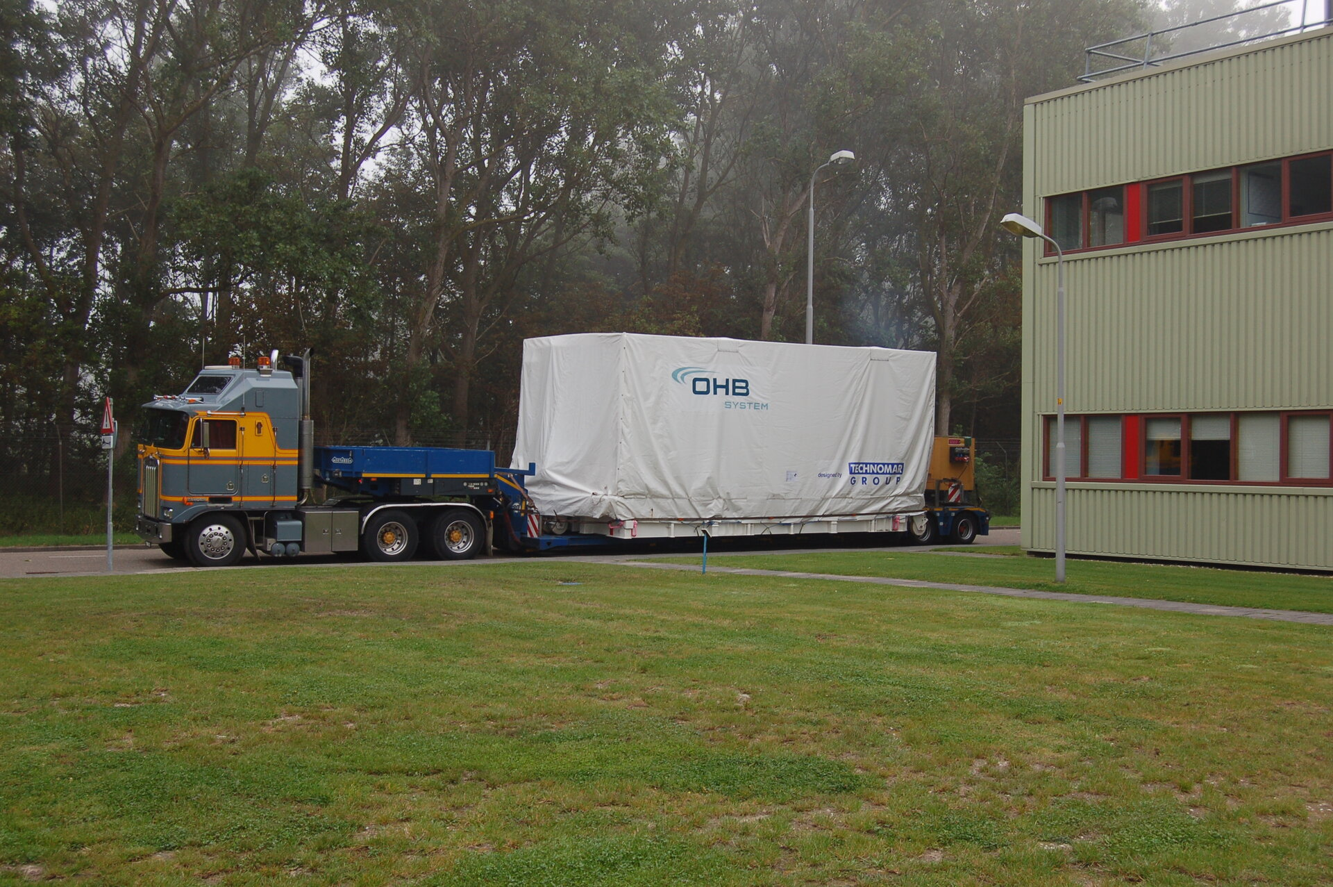 Small GEO arrives by truck at ESTEC