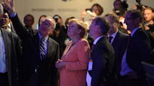 German Chancellor Angela Merkel visits the exhibition with Jean-
