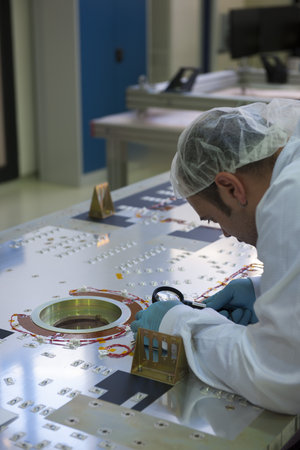 Engineer working on one of the first six Galileo FOC satellites at OHB