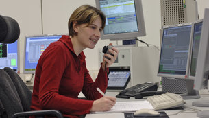 Software support engineers work on console at ESOC during critical mission phases