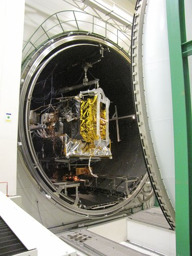 The vacuum chamber door closes