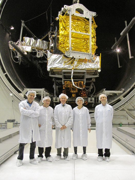 Alphasat's customer team take a final look before the chamber door is closed.