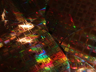 Silicon wafers etched with integrated circuits for space missions