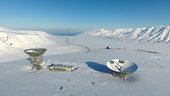 EISCAT Svalbard radar site features two antennas: a 32 meter mechanically fully steerable parabolic dish and a 42 meter fixed parabolic antenna