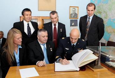 Luca Parmitano signs a commemorative book at the Cosmonautics Museum