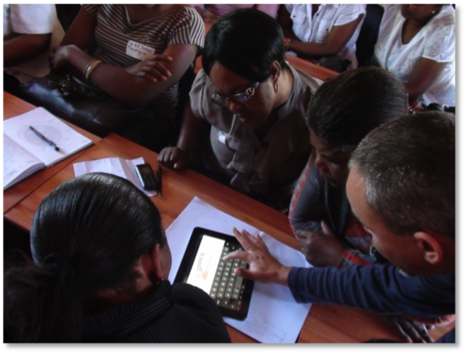 Teachers learning to use tablet computer