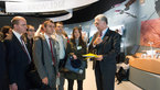 [15/19] Franco Bonacina presents to the French Ministry of Foreign Affairs Delegation the ESA pavilion