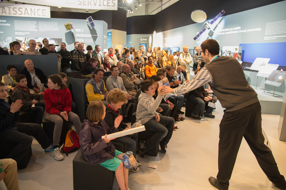 Public during a space quiz at ESA pavilion