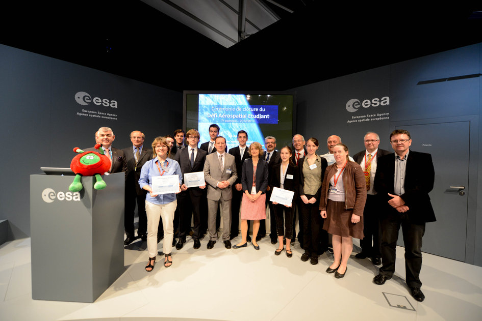 Students are presented with their prize in the Student Aerospace Challenge at the ESA's Pavilion