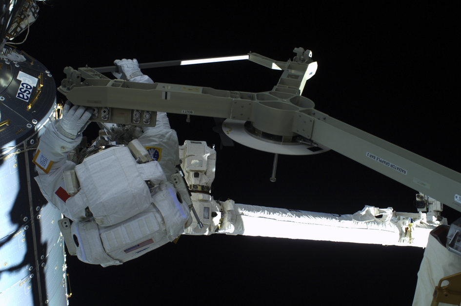 On the Canadarm, on the way to the port side