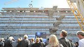 Watching the 'Richtkrone' being lifted into place at the Richftfest roof-topping ceremony for the new ESOC II buildings