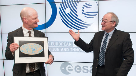 Mr Dordain presents UK Minister David Willetts with a picture of Planck CMB