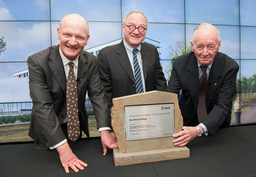Minister David Willetts, Mr Dordain and Roy Gibson celebrate the naming of ECSAT