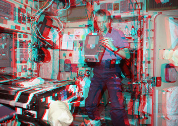 Thomas Reiter using ERB-1 on ISS in cyan-magenta 3D photo