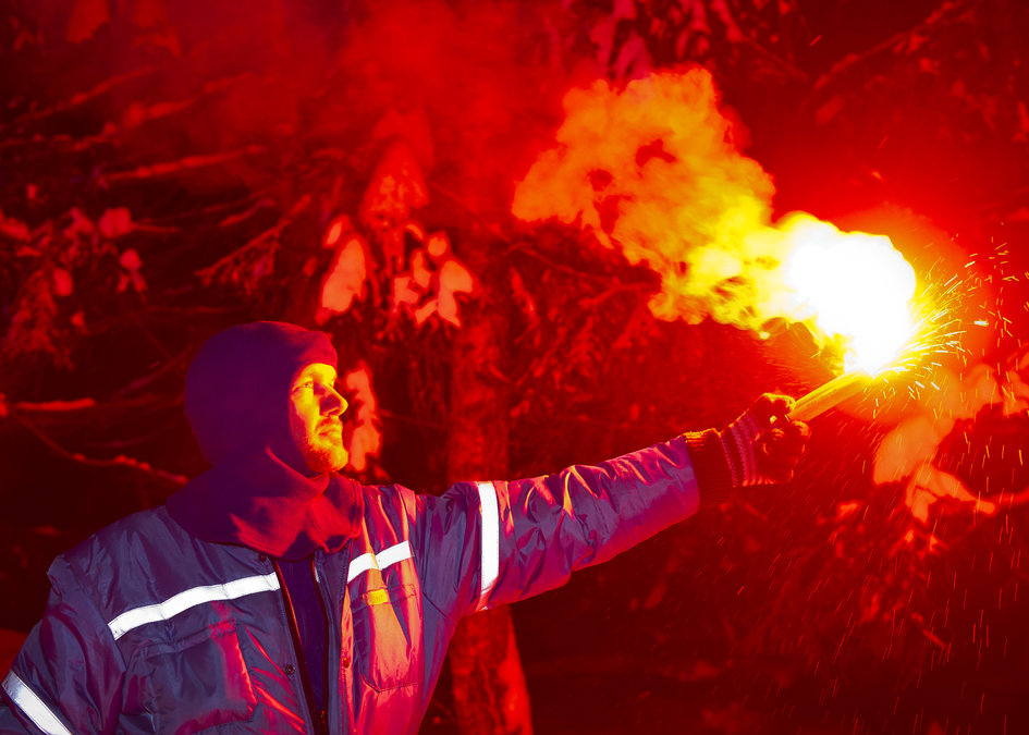 Alexander using a flare for survival training