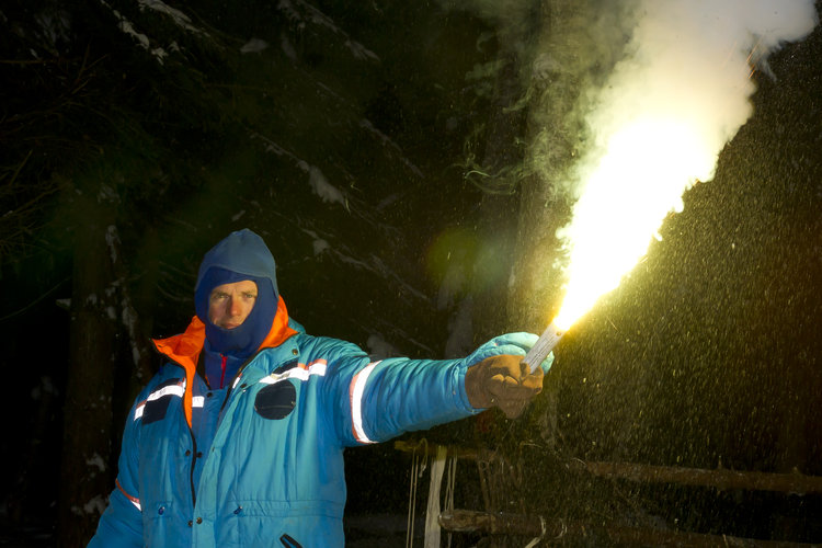 Andreas using a flare for survival training
