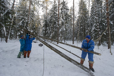 Building a shelter during winter survival training