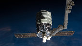 Orbital Sciences Corp. Cygnus commercial cargo craft attached to the end of the Canadarm2 robotic arm