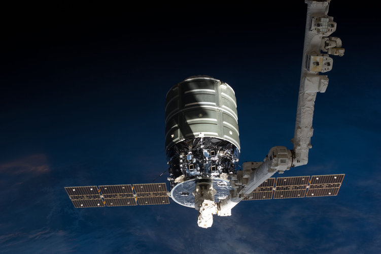 Cygnus craft attached to the ISS's robotic arm