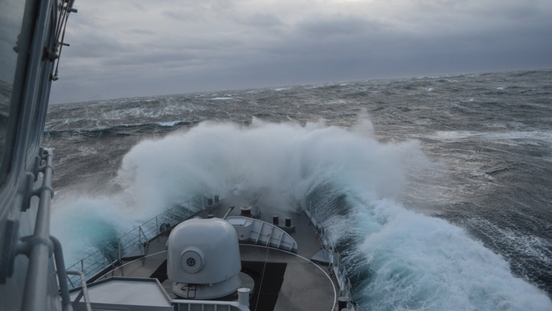 Frigate in rough waters