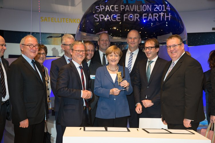 Angela Merkel at the 'Space for Earth' space pavilion at ILA