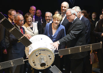 Angela Merkel visits the 'Space for Earth' space pavilion at ILA