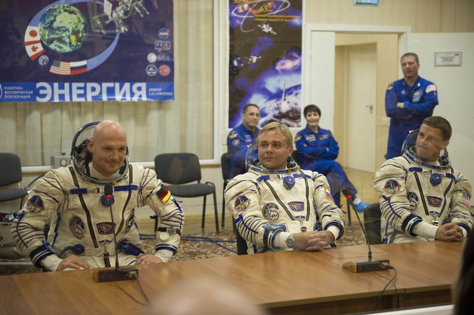Expedition 40/41 crew members dressed in their Russian Sokol suits