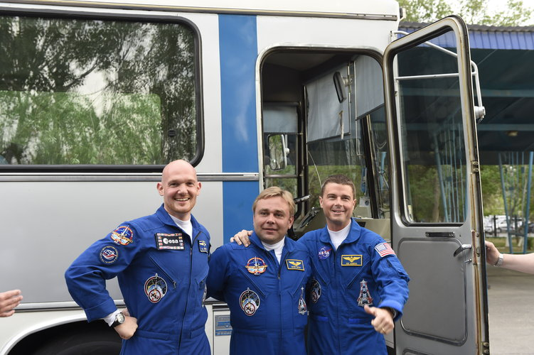Expedition 40/41 crew members shortly after leaving the Cosmonaut Hotel