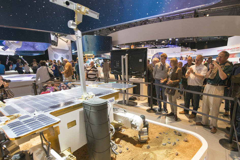 John B. Emerson visits the 'Space for Earth' space pavilion at ILA