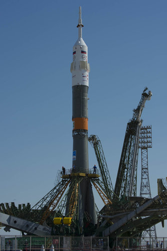 Soyuz TMA-13M spacecraft raised into vertical position