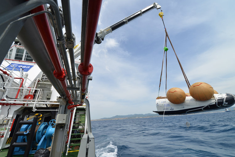 Closeup of IXV prototype being hoisted aboard