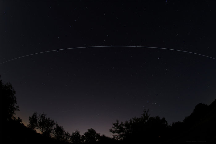 The International Space Station orbiting high above Darmstadt, Germany, in the evening of 6/7 June 2014