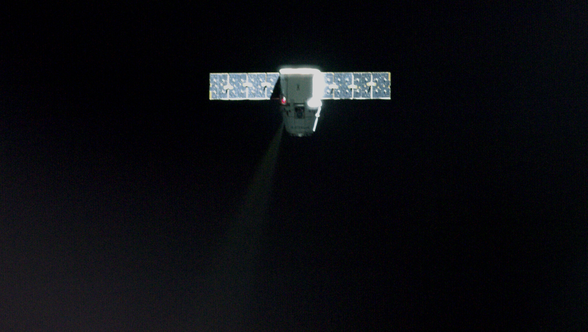 Dragon spacecraft approaching Space Station