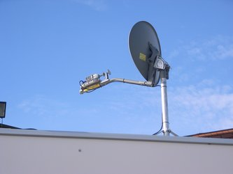 Self-pointing satellite dish on van