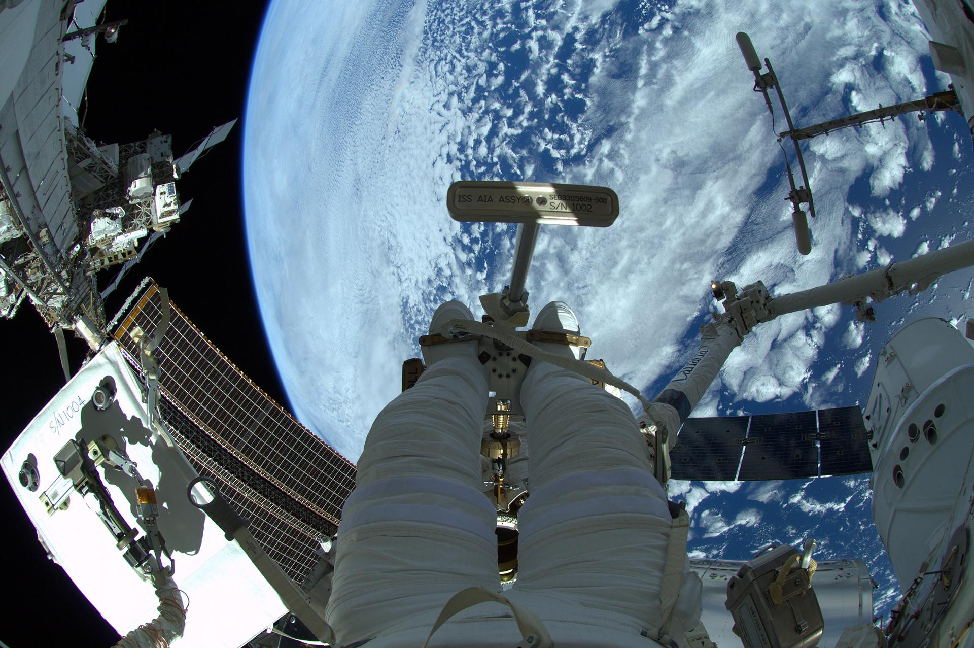 a 70 kg astronaut in space walking outside - photo #20