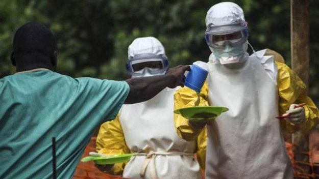 Ebola_workers_bring_food_to_patients_in_Sierra_Leone_large.jpg