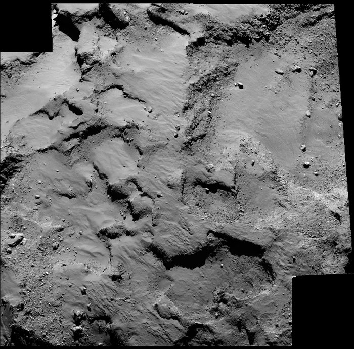 Close-up of the region containing Philae's primary landing site J, which is located on the 'head' of Comet 67P/Churyumov–Gerasimenko. The mosaic comprises two images taken by Rosetta's OSIRIS narrow-angle camera on 14 September 2014 from a distance of about 30 km. The image scale is 0.5 m/pixel.