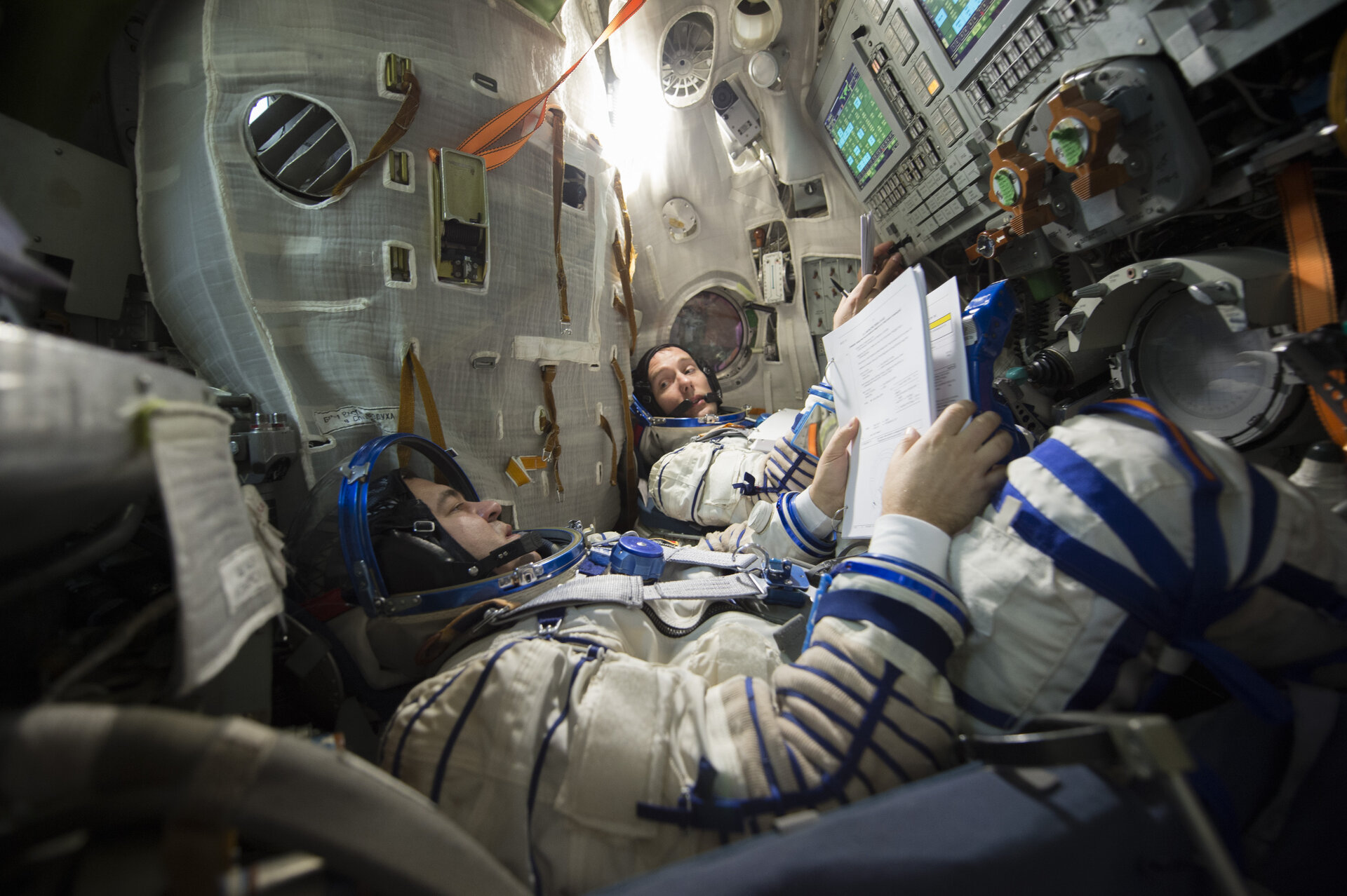 Thomas and Oleg  during training in the Soyuz TMA simulator