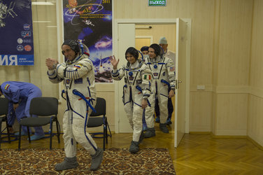 Expedition 42/43 crew members dressed in their Russian Sokol suit