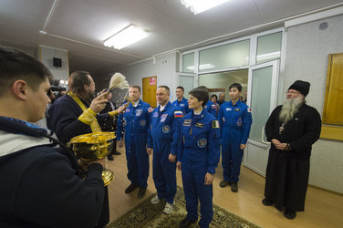 Expedition 42/43 crew members receive the traditional blessing