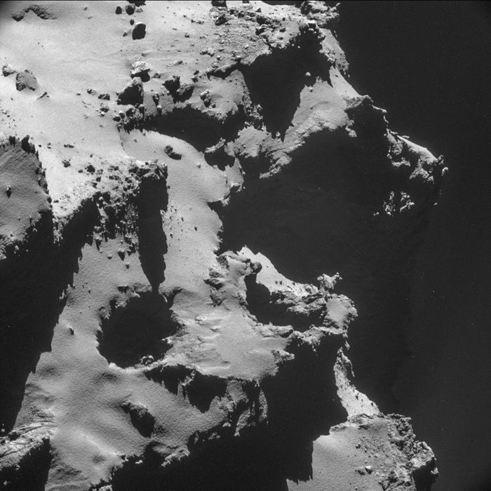 This image showcases one of the many pits seen on the surface of 67P/Churyumov–Gerasimenko.