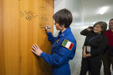 Samantha Cristoforetti performs the traditional door signing