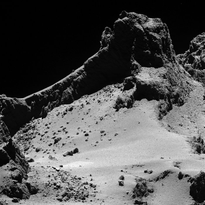 A section of the smaller of Comet 67P/Churyumov–Gerasimenko's two lobes as seen through Rosetta's narrow-angle camera from a distance of about 8 km to the surface on 14 October 2014. The resolution is 15 cm/pixel. The image is featured on the cover of 23 January 2014 issue of the journal Science.
