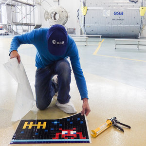 Invader installing art at ESA's astronaut centre