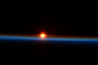 Eclipsed sunrise seen from International Space Station